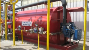American Heating Company industrial thermal fluid heater installed and functioning at a plant