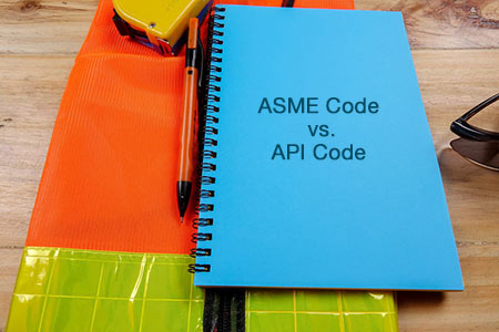 booklet titled ASME code vs. API code sitting on a construction vest