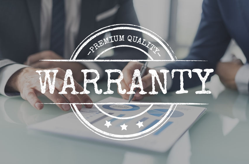 warranty stamp overlay over photo of businessmen reviewing a chart