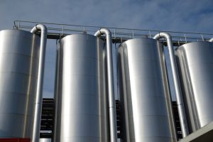 Storage silos contain cleaning chemicals for a factory