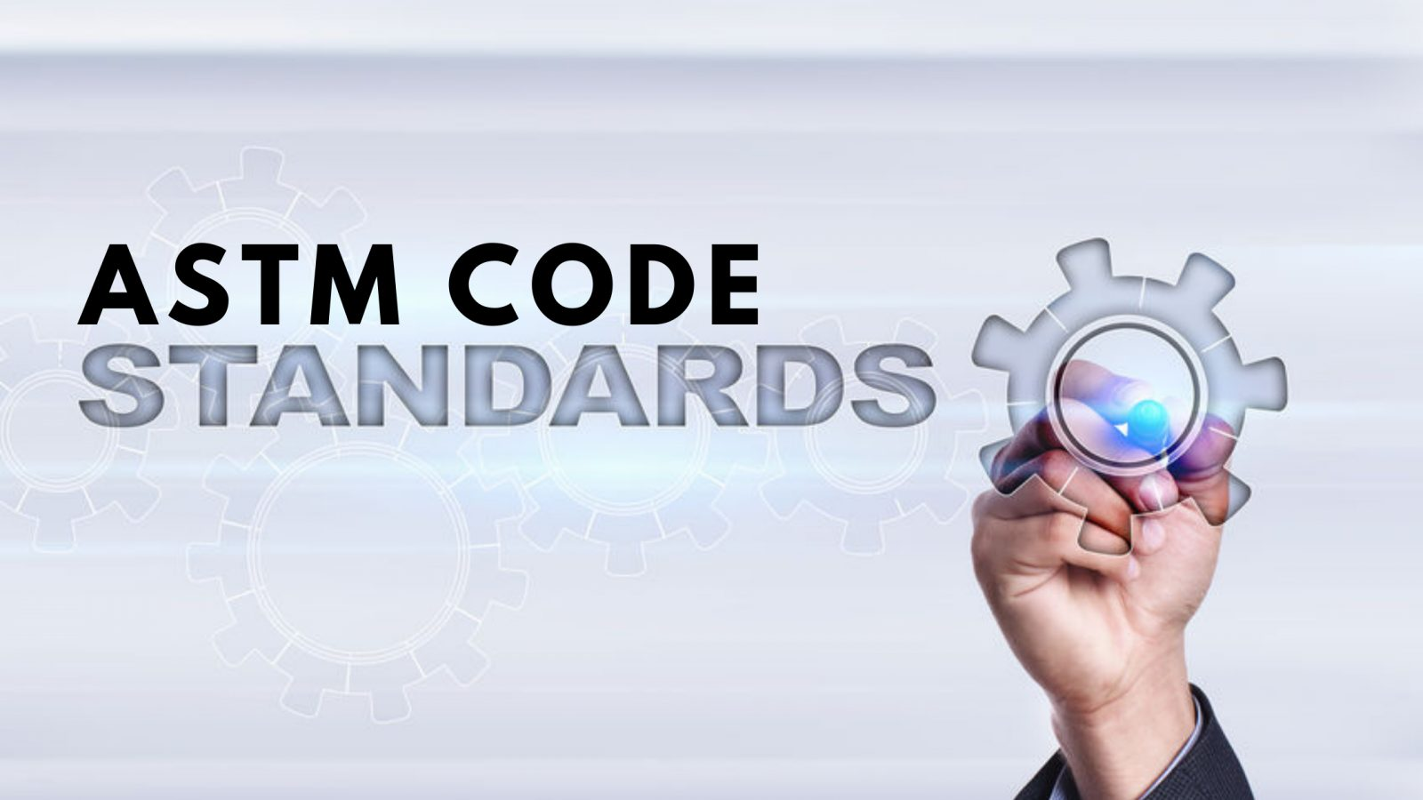 graphic with a hand pointing to a mechanical gear with the words ASTM code standards